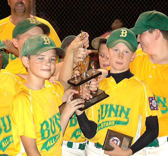 TEAMMATES WITH THE TROPHY.