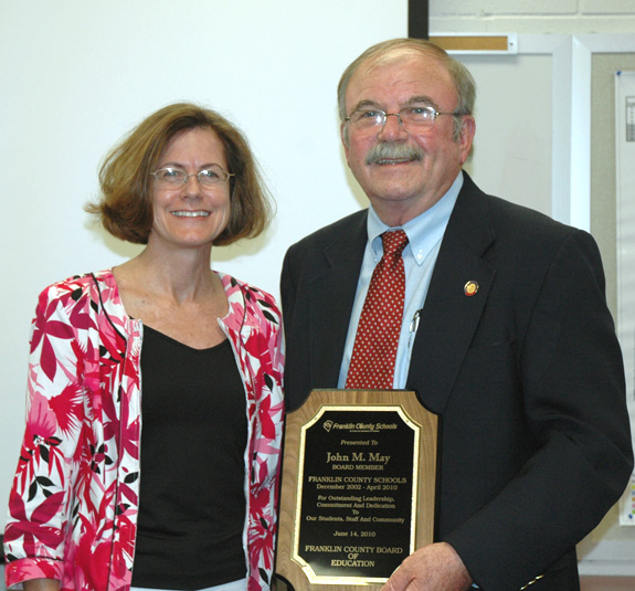 EX-BOARD MEMBER HONORED