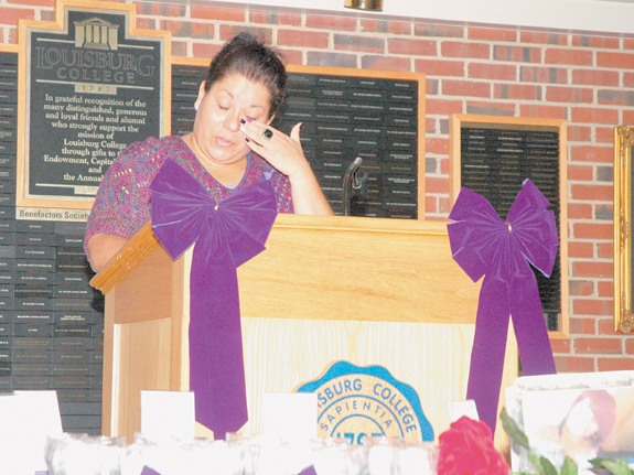 <i>Vigil helps focus attention on human cost of violence</i>