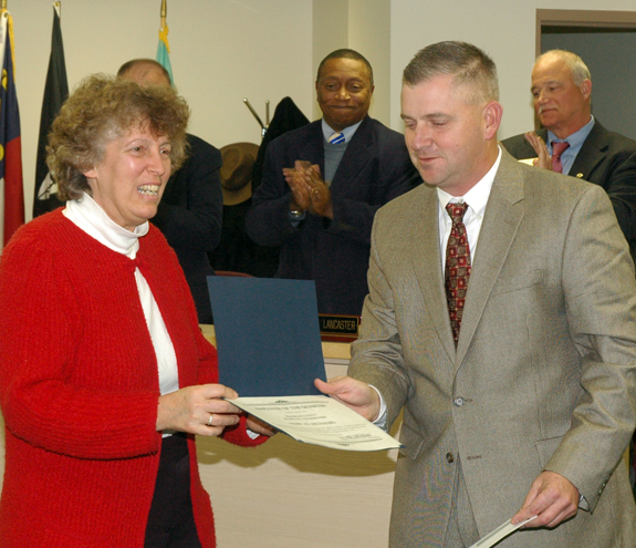 <i>County employees saluted</i>