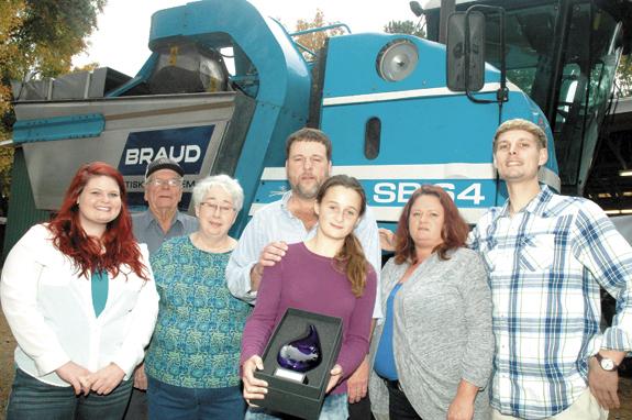 <i>Foster family reaps conservation award</i>
