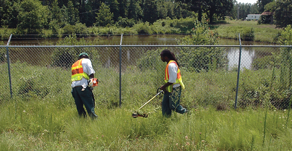 <i>Inmates getting grass cut at the airport</i>