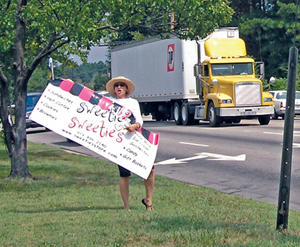 Disgruntled businesswoman hits streets, addresses Council